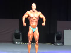 bodybuilder posing on stage