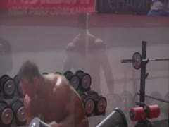 bodybuilder working out and posing