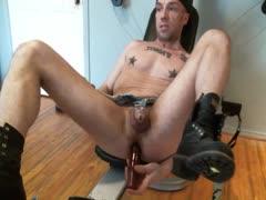 Muscle slut in chastity fucks his hole