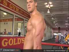 Brandon Myles White poses at the gym. PECS! BICEPS!